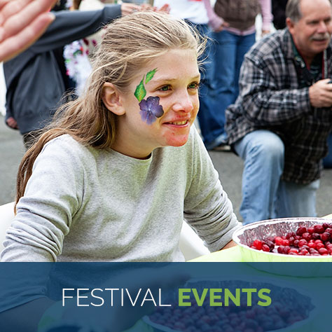 girl enjoying bandon cranberry festival events