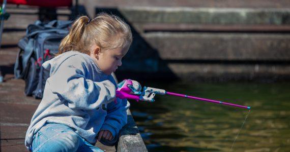 Little Girl Fishing on the pier